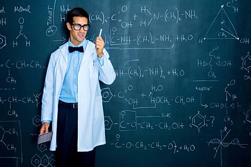 Scientist working on chemistry formulas