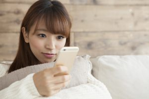 Women are laughing while watching the smartphone