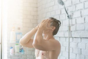 asian-men-are-taking-a-shower-in-the-bathroom-he-is-happy-and-relaxed_46139-601